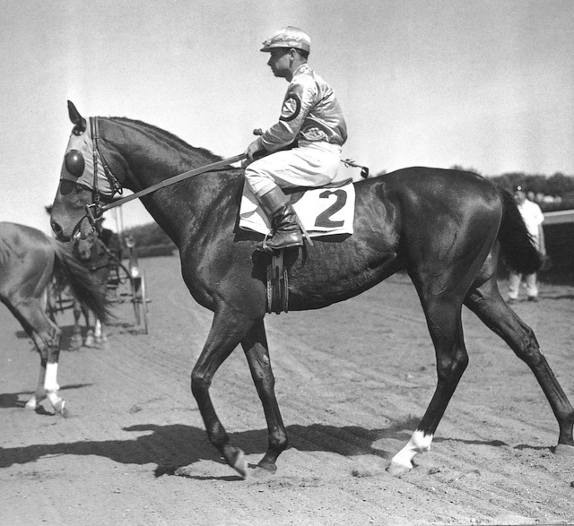 Count Fleet parades for his female fans prior to his score in the 1943 Kentucky Derby at Churchill Downs.